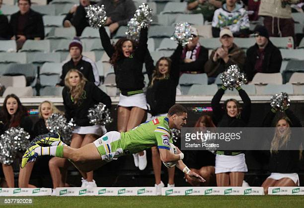 Brenko Lee of the Raiders scores a try during the round 13 NRL match between the Canberra Raiders and the Manly Sea Eagles at GIO Stadium on June 3...