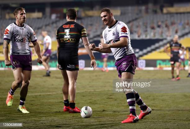 Brenko Lee of the Storm celebrates after scoring a try during the round six NRL match between the Penrith Panthers and the Melbourne Storm at...