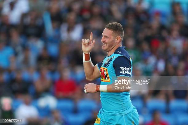 Brenko Lee of the Titans celebrates a try during the round 20 NRL match between the Gold Coast Titans and the New Zealand Warriors at Cbus Super...