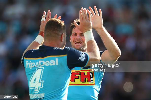 Brenko Lee of the Titans celebrates a try with Anthony Don during the round 20 NRL match between the Gold Coast Titans and the New Zealand Warriors...