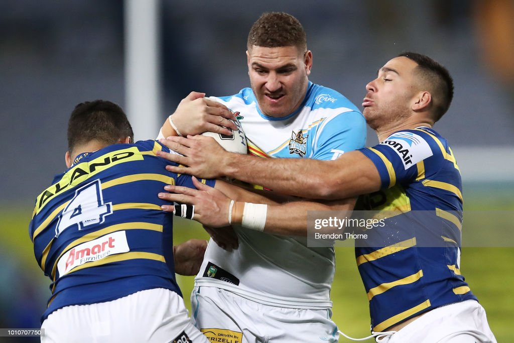 Brenko Lee of the Titans is tackled by the Eels defence during the round 21 NRL match between the Parramatta Eels and the Gold Coast Titans at ANZ Stadium on August 4, 2018 in Sydney, Australia.