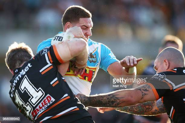 Brenko Lee of the Titans is tackled during the round 16 NRL match between the Wests Tigers and the Gold Coast Titans at Leichhardt Oval on July 1...