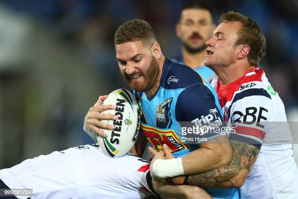 Brenko Lee of the Titans is tackled during the round 18 NRL match between the Gold Coast Titans and the Sydney Roosters at Cbus Super Stadium on July...
