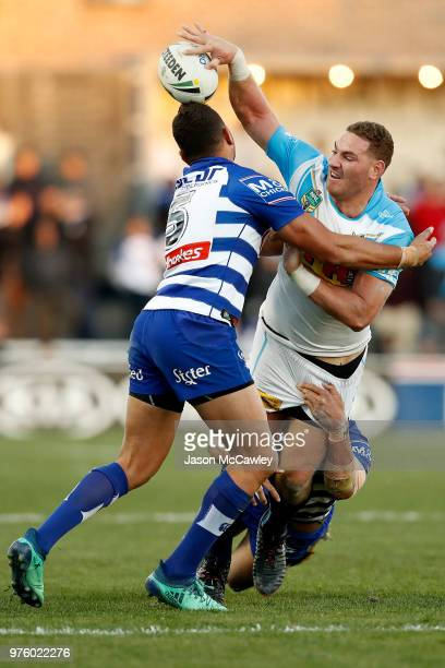 Brenko Lee of the Titans passes the ball during the round 15 NRL match between the Canterbury Bulldogs and the Gold Coast Titans at Belmore Sports...