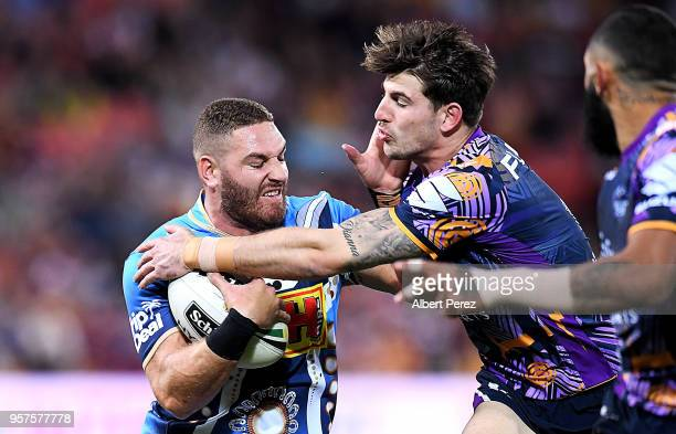 Brenko Lee of the Titans takes on the defence during the round ten NRL match between the Melbourne Storm and the Gold Coast Titans at Suncorp Stadium...