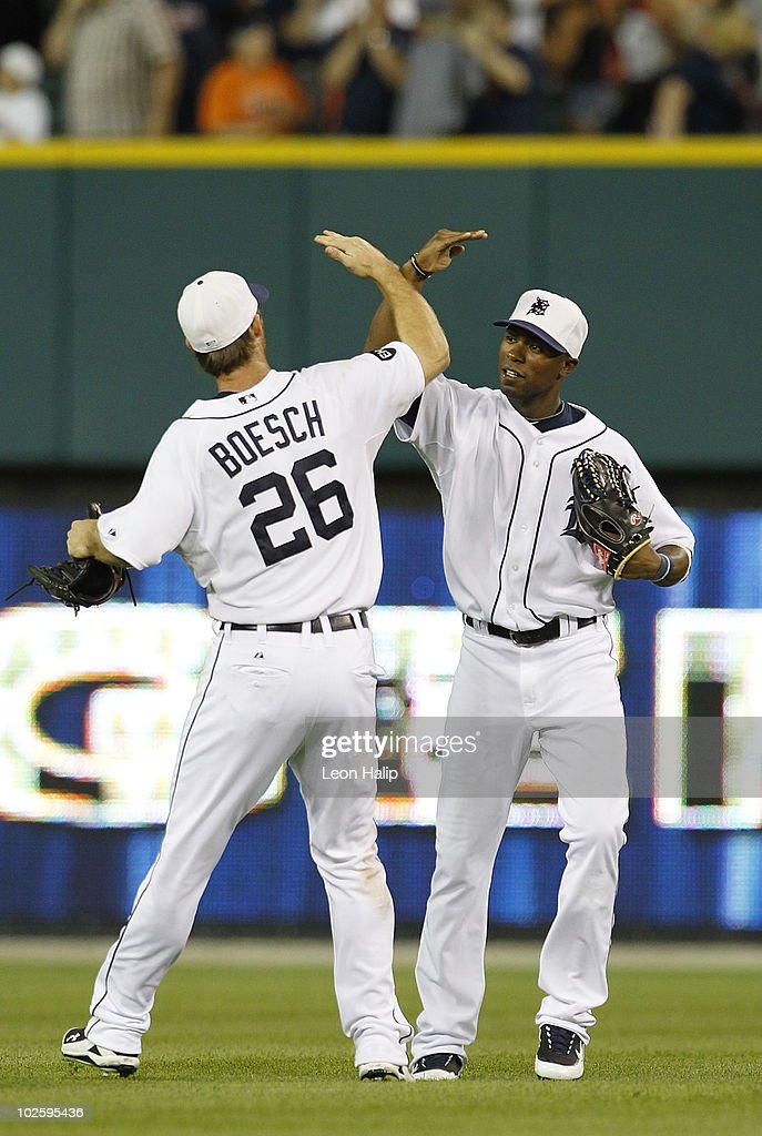 Brennan Boesch #26 and Austin Jackson #14 of the Detroit Tigers celebrate a 7-1 win over the Seattle Marines on July 2, 2010 at Comerica Park in Detroit, Michigan.