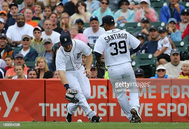 Brennan Boesch and Ramon Santiago of the Detroit Tigers make the play on the shallow single from Chris Stewart of the New York Yankees in the second...