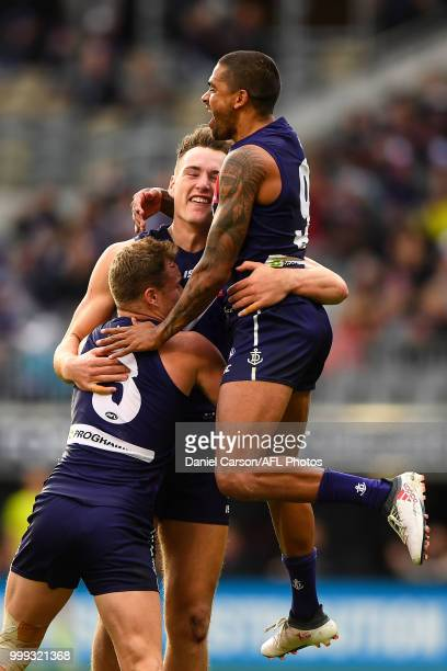 Brennan Cox and Bradley Hill of the Dockers celebrates a goal during the 2018 AFL round 17 match between the Fremantle Dockers and the Port Adelaide...