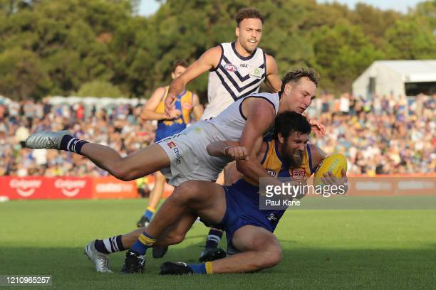 Brennan Cox of the Dockers tackles Josh Kennedy of the Eagles during the 2020 Marsh Community Series AFL match between the West Coast Eagles and the...