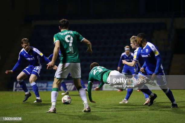 Brennan Johnson of Lincoln City is fouled by Kyle Dempsey of Gillingham FC which leads to a penalty awarded to Lincoln City during the Sky Bet League...