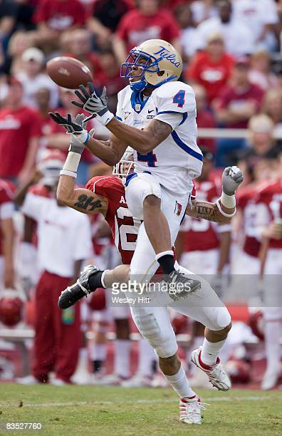 Brennan Marion of the Tulsa Golden Hurricanes catches a pass against the Arkansas Razorbacks at Donald W Reynolds Stadium on November 1 2008 in...