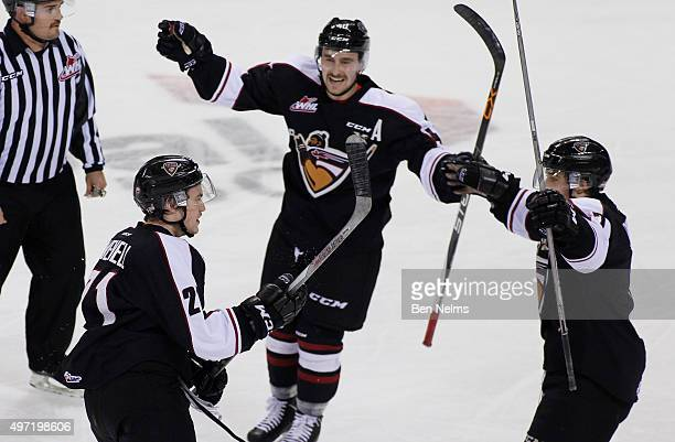 Brennan Menell of the Vancouver Giants celebrates his goal against the Portland Winterhawks with teammates Trevor Cox and Ty Ronning during the first...