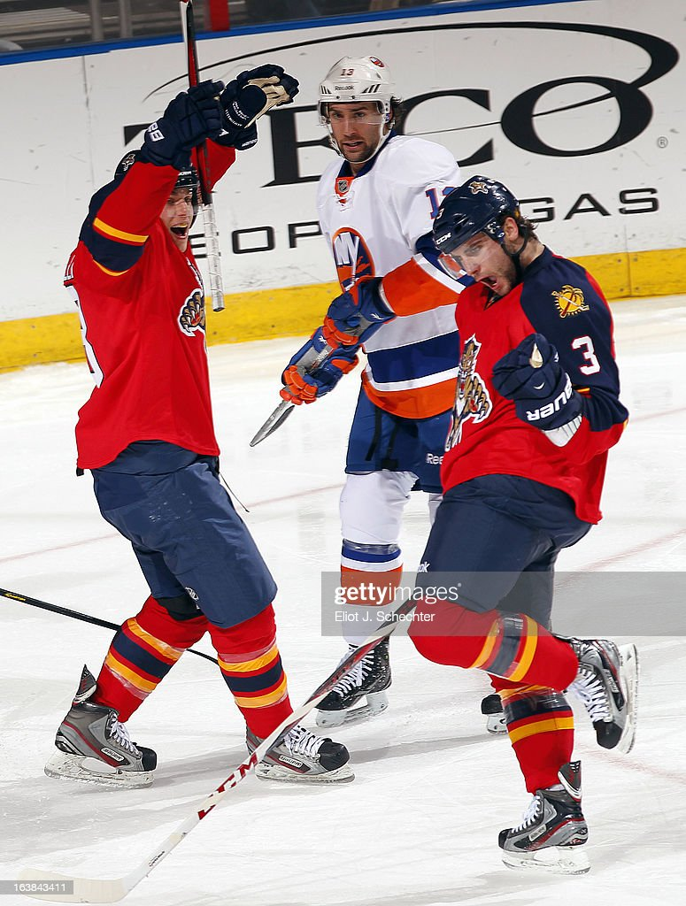 TJ Brennan #3 of the Florida Panthers celebrates his goal with teammate Mike Santorelli #13 against the New York Islanders at the BB&T Center on March 16, 2013 in Sunrise, Florida.
