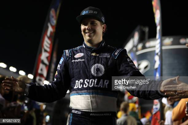 Brennan Poole driver of the DC Solar Chevrolet is introduced before the NASCAR XFINITY Series O'Reilly Auto Parts 300 at Texas Motor Speedway on...
