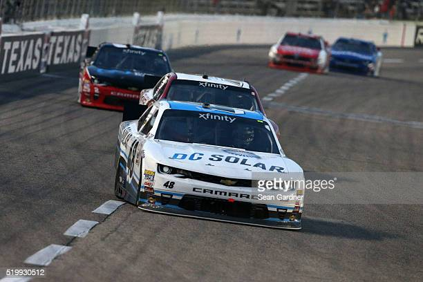 Brennan Poole driver of the DC Solar Chevrolet leads a pack of cars during the NASCAR XFINITY Series O'Reilly Auto Parts 300 at Texas Motor Speedway...