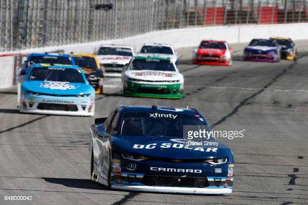 Brennan Poole driver of the DC Solar Chevrolet leads a pack of cars during the NASCAR XFINITY Series Rinnai 250 at Atlanta Motor Speedway on March 4...