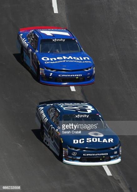 Brennan Poole driver of the DC Solar Chevrolet leads Elliott Sadler driver of the OneMain Financial Chevrolet during the NASCAR XFINITY Series My...