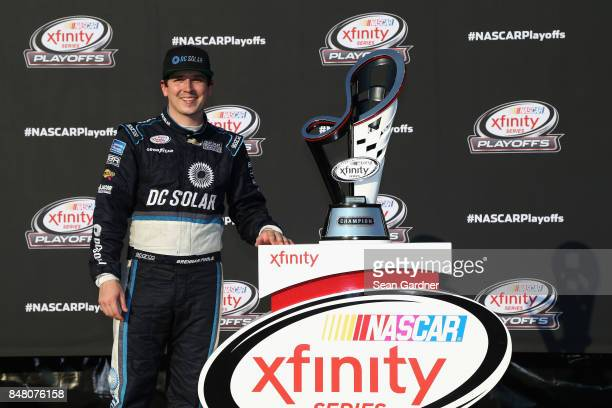Brennan Poole driver of the DC Solar Chevrolet poses for a photo opportunity following the NASCAR XFINITY Series TheHousecom 300 at Chicagoland...
