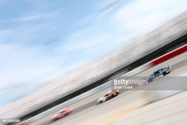 Brennan Poole driver of the DC Solar Chevrolet races during the NASCAR XFINITY Series Sports Clips Haircuts VFW 200 at Darlington Raceway on...