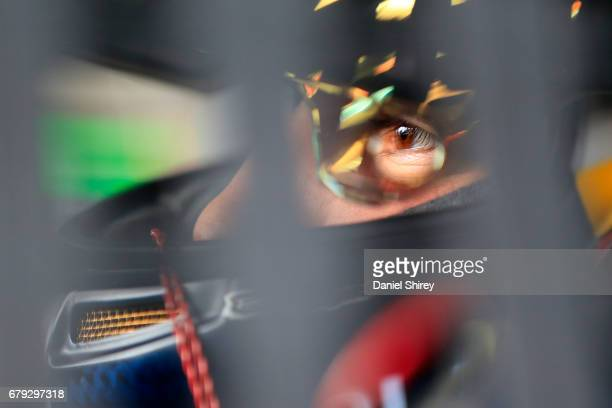 Brennan Poole driver of the DC Solar Chevrolet sits in his car during practice for the NASCAR XFINITY Series Sparks Energy 300 at Talladega...