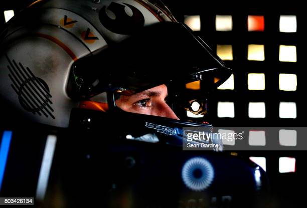 Brennan Poole driver of the DC Solar Chevrolet sits in his car during practice for the NASCAR XFINITY Series CocaCola Firecracker 250 at Daytona...