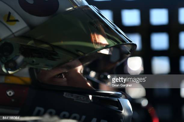 Brennan Poole driver of the DC Solar Chevrolet sits in his car during practice for the NASCAR XFINITY Series Virginia529 College Savings 250 at...