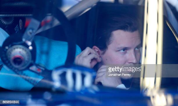 Brennan Poole driver of the DC Solar Chevrolet sits in his car during practice for the NASCAR XFINITY Series O'Reilly Auto Parts 300 at Texas Motor...
