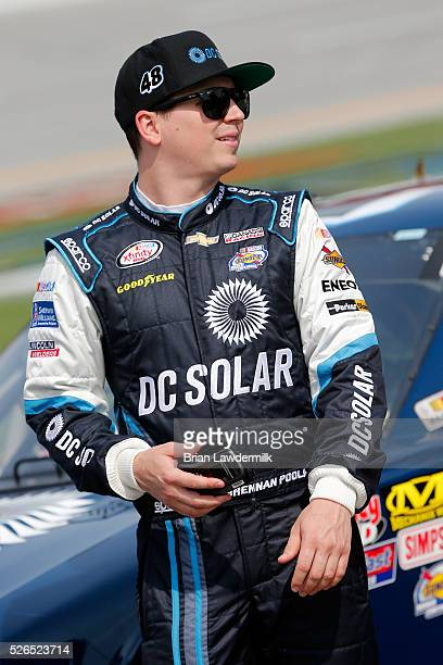 Brennan Poole driver of the DC Solar Chevrolet stands on the grid during qualifying for the NASCAR XFINITY Series Sparks Energy 300 at Talladega...