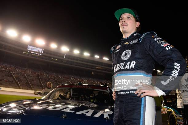 Brennan Poole driver of the DC Solar Chevrolet stands on the grid before the NASCAR XFINITY Series O'Reilly Auto Parts 300 at Texas Motor Speedway on...