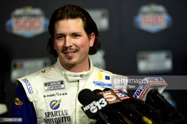 Brennan Poole driver of the SpartanGo Chevrolet speaks with the media during the NASCAR Cup Series 62nd Annual Daytona 500 Media Day at Daytona...