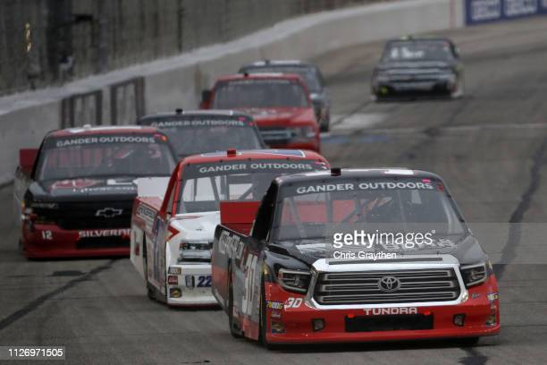 Brennan Poole driver of the Toyota leads a pack of cars during the NASCAR Gander Outdoors Truck Series Ultimate Tailgating 200 at Atlanta Motor...