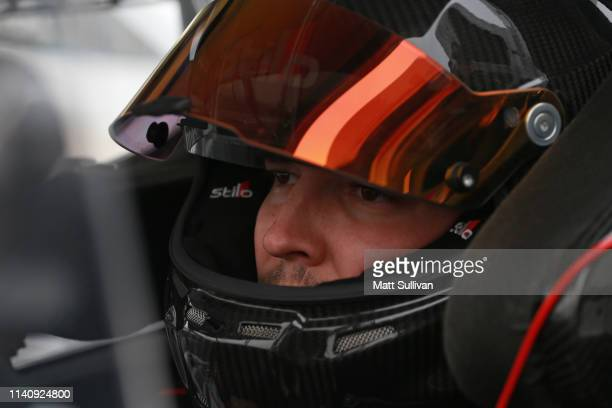 Brennan Poole driver of the Toyota sits in his truck during qualifying for the NASCAR Gander Outdoors Truck Series JEGS 200 at Dover International...