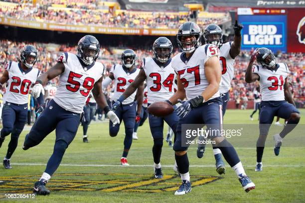 Brennan Scarlett of the Houston Texans celebrates with teammates after intercepting a pass in the second quarter of the game against the Washington...