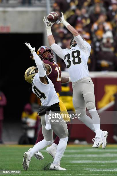 Brennan Thieneman of the Purdue Boilermakers breaks up a pass intended for Rashod Bateman of the Minnesota Golden Gophers as teammate Antonio...