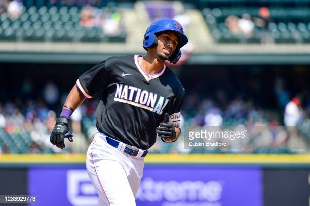 Brennen Davis of National League Futures Team rounds the bases after hitting a solo home run against the National League Futures Team for his second...