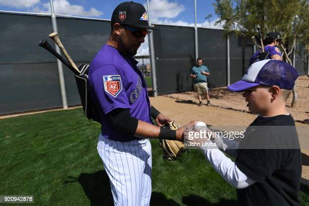 Brennen Larson of Glendale AZ gets and autograph from Colorado Rockies Noel Cuevas during the teams workout on February 19 2018 at Salt River Fields...
