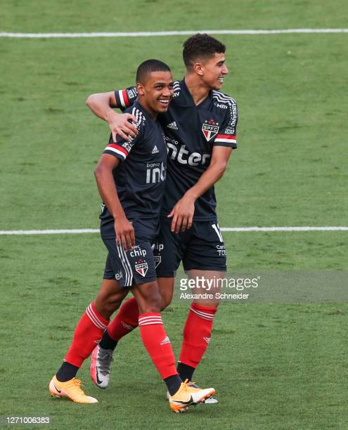 Brenner and Vitor Bueno of Sao Paulo celebrate the first goal of their team during the match against Fluminense as part of the Brasileirao Series A...