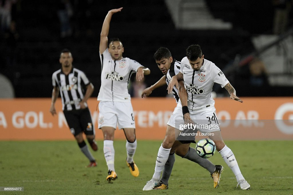 Brenner (L) of Botafogo battles for the ball with Pedro Henrique of Corinthians during the match between Botafogo and Corinthians as part of Brasileirao Series A 2017 at Engenhao Stadium on October 23, 2017 in Rio de Janeiro, Brazil.