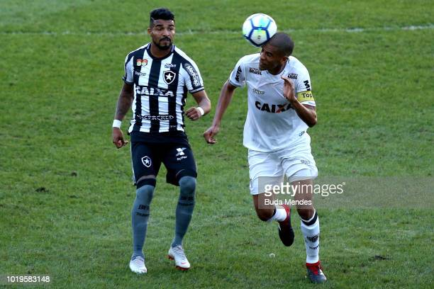Brenner of Botafogo struggles for the ball with Leonardo Silva of Atletico during a match between Botafogo and Atletico MG as part of Brasileirao...