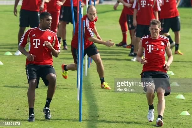 Breno Arjen Robben and Bastian Schweinsteiger exercise during a training session of Bayern Muenchen at the ASPIRE Academy for Sports Excellence on...