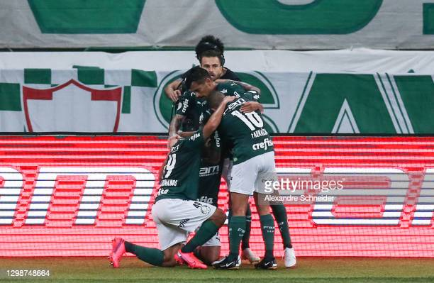 Breno Lopes of Palmeiras celebrates with his team mates after scoring the first goal of their team during a match between Palmeiras and Vasco da Gama...