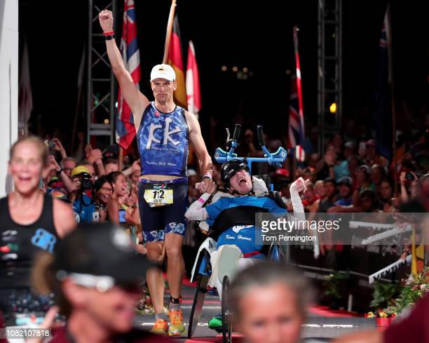 Brent and Kyle Pease celebrate after finishing the IRONMAN World Championships brought to you by Amazon on October 13 2018 in Kailua Kona Hawaii