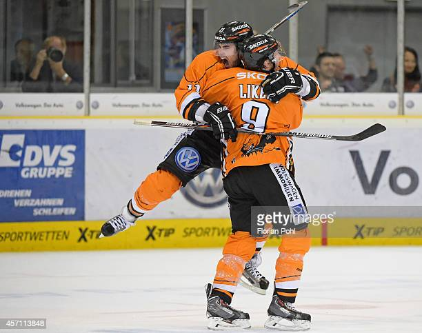 Brent Aubin and Jeff Likens of Grizzly Adams Wolfsburg celebrate after scoring the 4:3 goal during the DEL game between EHC Wolfsburg and Eisbaeren...