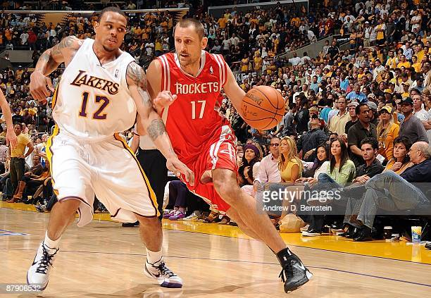 Brent Barry of the Houston Rockets drives to the basket against Shannon Brown of the Los Angeles Lakers in Game Seven of the Western Conference...