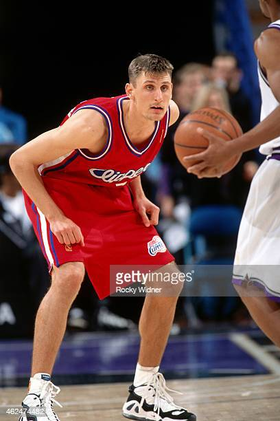Brent Barry of the Los Angeles Clippers defends against the Sacramento Kings during a game circa 1997 at Arco Arena in Sacramento California NOTE TO...