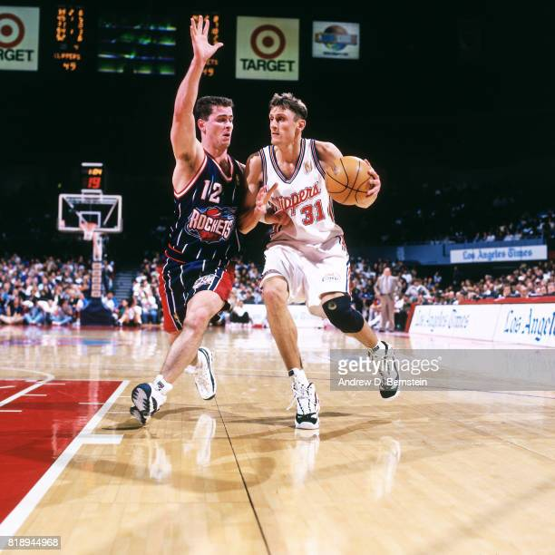 Brent Barry of the Los Angeles Clippers drives against Matt Maloney of the Houston Rockets during a game at the Los Angeles Memorial Sports Arena in...