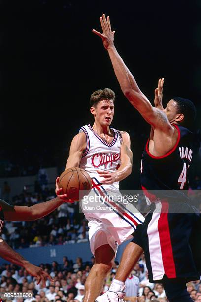 Brent Barry of the Los Angeles Clippers goes to the basket against the Portland Trail Blazers in Circa 1997 at the Los Angeles Memorial Sports Arena...