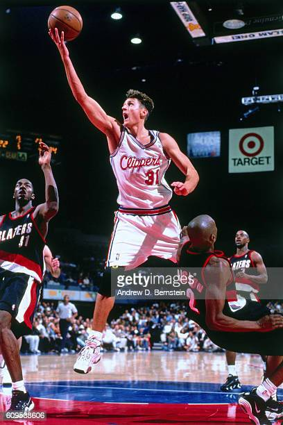 Brent Barry of the Los Angeles Clippers goes to the basket against the Portland Trail Blazers in Circa 1998 at the Los Angeles Memorial Sports Arena...