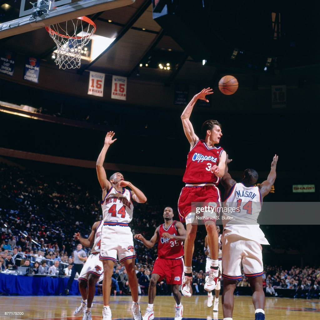 Brent Barry #35 of the Los Angeles Clippers passes the ball during a game played on March 5, 1996 at Madison Square Garden in New York City .
