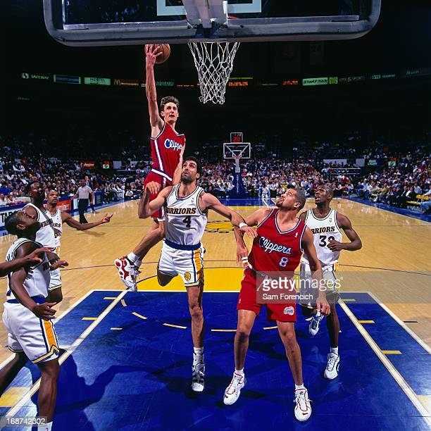 Brent Barry of the Los Angeles Clippers shoots the ball against the Golden State Warriors circa 1996 at the OaklandAlameda County Coliseum Arena in...